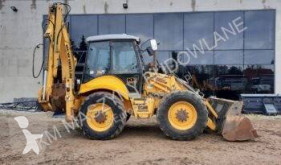 New Holland B 115 LB 115 JCB 4CX CAT 434 444 CASE 695 KOMATSU WB93 WB97 tweedehands vaste graaflaadcombinatie