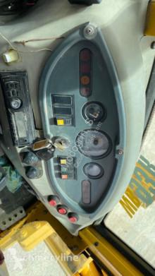 View images Komatsu WB93 R-2 backhoe loader