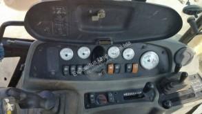 Bekijk foto's Graaflaadmachine Caterpillar 432D