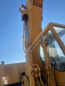 Просмотреть фотографии Экскаватор Caterpillar 215B