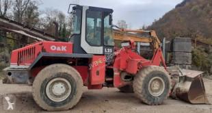 Pá carregadora O&K L 25 C pá carregadora sobre pneus usada