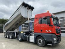 MAN TGX 18.460 4x4H BLS - Kipphyd. + Thermo Kipp. tractor-trailer used tipper