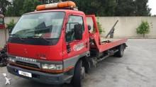 Camión de asistencia en ctra Mitsubishi Canter