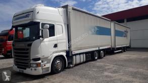 tweedehands vrachtwagen met aanhanger met huifzeil schuifbare zeilafdekking