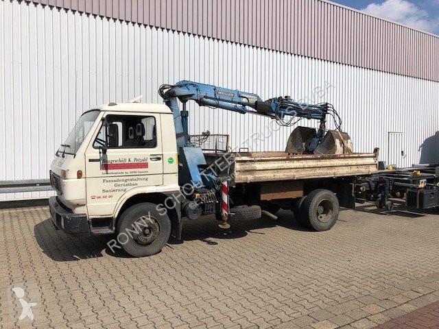 Voir les photos Camion MAN 10.150 L04  4x2  4x2, Kran Meiller MK56RS gegen Aufpreis