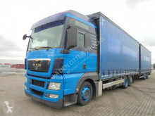 MAN TGX trailer truck used tautliner