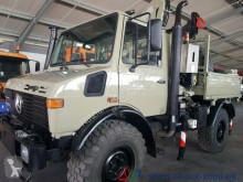 ciężarówka Unimog U1450 4x4 Fassi Kran mit FB + Winde Bergstütze