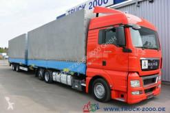 Lastbil med släp flexibla skjutbara sidoväggar MAN TGX TGX 26.400 Jumbo Komplettzug mit Brücken HU7/20