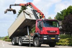 Camión Iveco Trakker volquete volquete trilateral usado