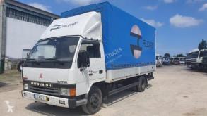 Vrachtwagen Mitsubishi Canter FE444 tweedehands met huifzeil