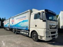 Used box trailer truck MAN TGX TGX 26.440 mit Anhänger Getränke LDW 2.000kg