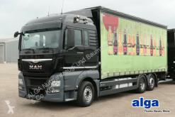 Lastbil med släp flexibla skjutbara sidoväggar skjutbart presenningssystem MAN TGX 26.480 TGX LL 6x2, Getränke, LBW, Kompl. Zug