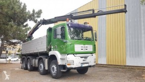 MAN TGA 35.410 truck used three-way side tipper