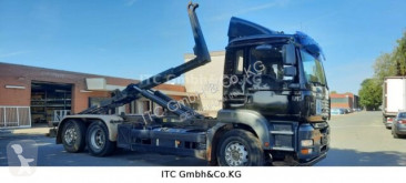 MAN TGA 26440 Abrollkipper truck used hook arm system