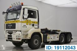 Camião MAN TGA 33.400 poli-basculante usado