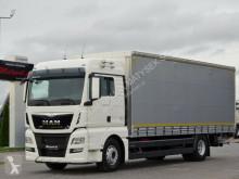 Camião MAN TGX 18.440 / MANUAL / EURO 6 / L: 8 M /ELEVATOR caixa aberta com lona usado