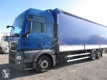 Camião MAN TGX 26.440 caixa aberta com lona usado