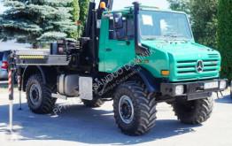 Camião Unimog 4x4 HIAB 166 E4 HIPRO OFF ROAD Kran CRAN estrado / caixa aberta caixa aberta usado