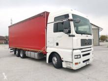 Camião MAN TGA 24.400 caixa aberta com lona usado