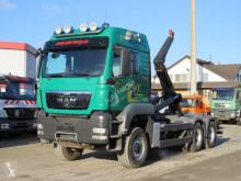 Camión Gancho portacontenedor MAN TGS TG-S 26.540 6x6 Abrollkipper Meiller