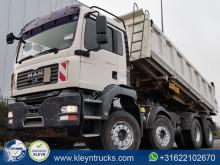 Camión MAN TGA 37.440 volquete trilateral usado