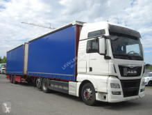 Vrachtwagen met aanhanger met huifzeil MAN 26480LL / KOMPLETER ZUG