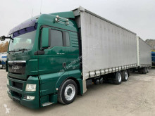 Vrachtwagen met aanhanger MAN TGX TGX 26.440 Jumbo-Zug 6x2 Durchladerampe tweedehands Schuifzeilen