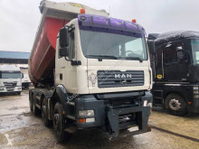MAN TGA 41.460 truck used three-way side tipper