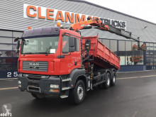 MAN TGA 33.360 truck used three-way side tipper