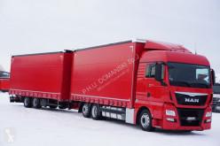 MAN TGX / 24.440 / ACC / E 6 / RETARDER ZESTAW + remorque rideaux coulissants truck used tautliner