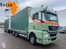 Lastbil med släp skjutbara ridåer (flexibla skjutbara sidoväggar) MAN TGX 26.400