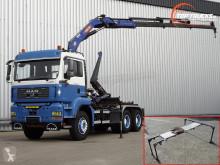 Camión MAN TGA 33.390 Gancho portacontenedor usado