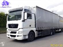 Vrachtwagen met aanhanger Schuifzeilen MAN TGX 26.440