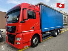 Lastbil MAN TGX tgx 26.480 seitencurder skjutbara ridåer (flexibla skjutbara sidoväggar) begagnad