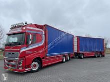 Lastbil med släp skjutbara ridåer (flexibla skjutbara sidoväggar) Volvo FH16.650 6x2 POULTRY / GEFLÜGEL/ CHICKEN WITH TRAILER