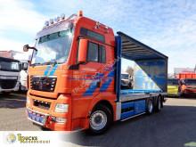 Camion MAN TGX 26.440 Teloni scorrevoli (centinato) usato
