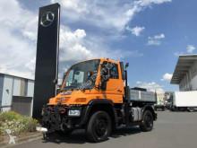 Vrachtwagen Unimog UNIMOG U300 4x4 tweedehands platte bak boorden