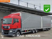 Lastbil med släp skjutbara ridåer (flexibla skjutbara sidoväggar) MAN TGX 26.480
