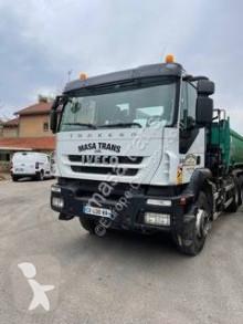 Camión Iveco Trakker 330 volquete volquete trilateral usado