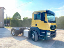 MAN hook lift truck TGS 46 BALESTRATO ANTERIORE E PNEUMATICO POSTE