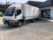 Camion cu prelata si obloane Mitsubishi Fuso Canter
