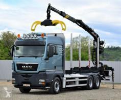 Camión MAN TGX 26.480 Holztransporter + LOGLIFT 115Z80A/6x4 caja abierta usado