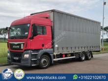 Camion MAN TGX 26.480 Teloni scorrevoli (centinato) usato