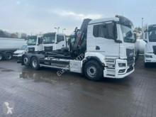 Camión Gancho portacontenedor MAN TGS TGS 26.470 6x2 Abrollkipper + Kran Hiab 228-4