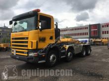 Camión Gancho portacontenedor Scania R124