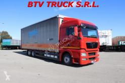 Ciężarówka MAN TGX TGX 26 440 MOTRICE CENTINATA FRANCESE 9,40 EURO 5 firanka używana