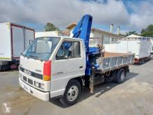 Camión Isuzu NKR volquete volquete trilateral usado