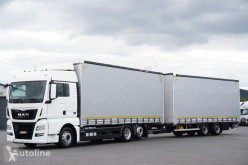 Ciężarówka MAN TGX / 26.440 / EURO 6 / ZESTAW PRZEJAZDOWY 120 M3 + remorque rideaux coulissants firanka używana
