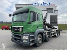 Camión MAN TGS 35.440 8x2 M TEC HLS20 Silo Steller Gancho portacontenedor usado