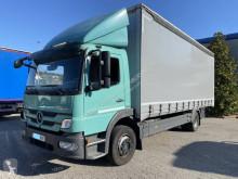 Mercedes függönyponyvaroló teherautó Atego 1222
